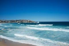 Watching the surf, Bondi Beach, Sydney , Australia. Blue skys and water at Bondi Beach, Sydney, Australia stock image