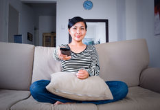 Watching television Stock Images