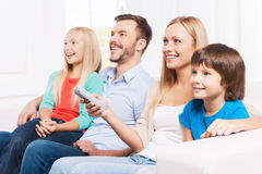 Watching their favorite show. Royalty Free Stock Images