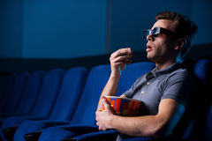 Watching three-dimensional movie. Royalty Free Stock Images