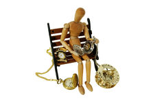 Watching time. Gold and silver pocket watch with a metal chain, measuring time passing with a clock, Wooden model representing a person on a bench royalty free stock image