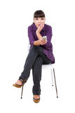 Watching tv. Young adult woman watching tv. over white background Royalty Free Stock Images
