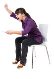 Watching tv. Young adult woman watching tv. over white background Stock Image