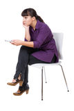 Watching tv. Young adult woman watching tv. over white background Stock Photos