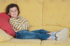 Watching TV. Adorable child Watching TV in his home Stock Photo