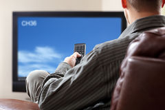 Watching tv royalty free stock photos