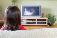 Watching tv Stock Photos