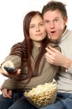 Watching tv. Young couple is watching tv Royalty Free Stock Image