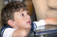 Watching TV. Young Boy Watching TV Stock Photo