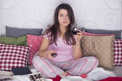 Watching TV in bed Stock Images