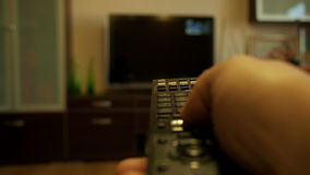 Watching TV-changing channels, blurred TV. Watching TV-changing channels, remote rv stock video