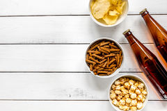 Watching TV with chips, beer and pop corn on white background top view mock up Stock Image