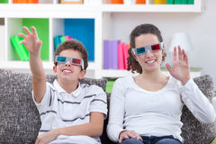 Watching TV with 3D glasses. Children watching TV with 3D glasses at home Stock Image