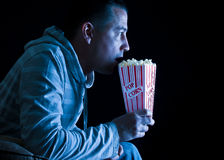 Watching TV , eating popcorn Royalty Free Stock Images