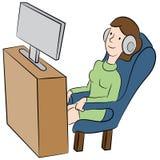 Watching TV with Headphones Stock Image