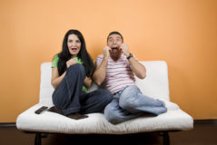 Watching TV a horror movie Stock Photo