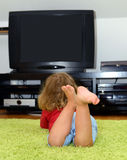 Watching TV. Little child is watching TV Stock Photography