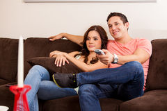 Watching TV with my girlfriend Stock Images