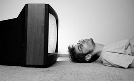 Free Watching TV On The Floor Stock Photos - 16113663