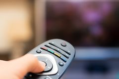 Watching TV and pressing remote controller in first person views royalty free stock photo