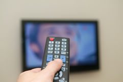 Watching TV remote. Watching TV with a remote Royalty Free Stock Images