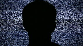 Watching TV Static Noise. Silhouette of person wathcing static on HD 1080 TV. Seamless HD 1080 Loop. Shot on HDV 1080 stock video