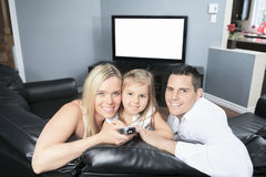 Watching TV together at home Royalty Free Stock Photos
