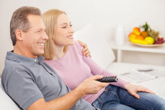 Watching TV together. Stock Image