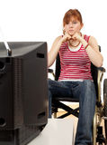 Watching tv woman on the wheelchair Royalty Free Stock Photography