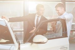 Watching vehicle in dealership Royalty Free Stock Photos