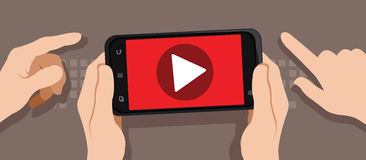 Watching video with smartphone Stock Image