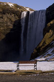 Watching the waterfalls. A bench in front of the waterfalls Royalty Free Stock Image
