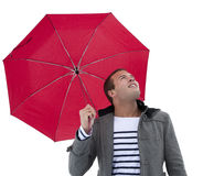 Watching the Weather. A young, attractive male looks upwards to check the weather. Multi-ethnic model isolated on a white background Stock Photo