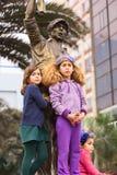 Watching the Wong Parade in Lima, Peru Royalty Free Stock Image
