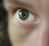 Watching you. Female eye with soft focus on everything but the eye Royalty Free Stock Photos