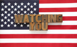 Watching you in wood type on flag. USA flag with the words watching you in letterpress wood type letters Royalty Free Stock Photography
