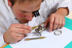 Watchmaker. In his workshop repairing a wrist watch. Intentional shallow depth of field, focus on the eye Royalty Free Stock Photo