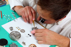 Watchmaker. In his workshop repairing a wrist watch. Intentional shallow depth of field, focus on the eye Royalty Free Stock Photos