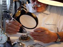 Watchmaker. With turnscrew and pincers Stock Photography