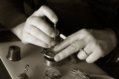 Watchmaker. With turnscrew and pincers Royalty Free Stock Photography