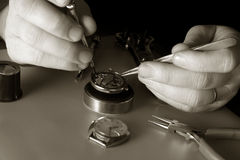Watchmaker. With turnscrew and pincers Stock Photos