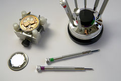 Watchmaker. A view with some watchmaker tools Royalty Free Stock Photography