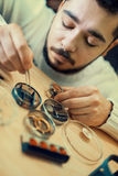 Watchmaker. Close up portrait of a watchmaker at work.A watchmaker or repair man in action,viewing very closely Royalty Free Stock Photography