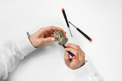 Watchmaker holding antique pocket watch show the c royalty free stock image