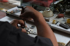 Watchmaker. Repairing and cleaning the machine Royalty Free Stock Image