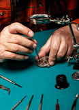 Watchmaker repairing an old pocket watch Stock Photo