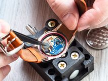 Watchmaker repairs quartz wristwatch close up royalty free stock photo