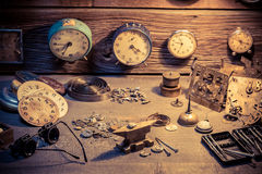 Watchmaker's room with parts of clocks. Closeup of watchmaker's room with parts of clocks stock image