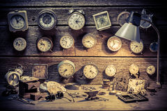 Watchmaker's workshop with clocks to repair. Closeup of watchmaker's workshop with clocks to repair Royalty Free Stock Photo