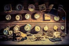 Watchmaker's workshop with damaged clocks. Closeup of watchmaker's workshop with damaged clocks stock image